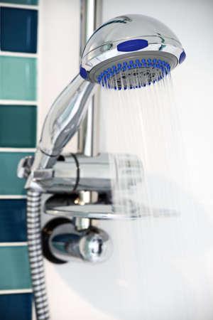 steel head: Shower head with flowing water spray