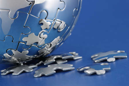 Global environment solution concept - earth jigsaw puzzle photo