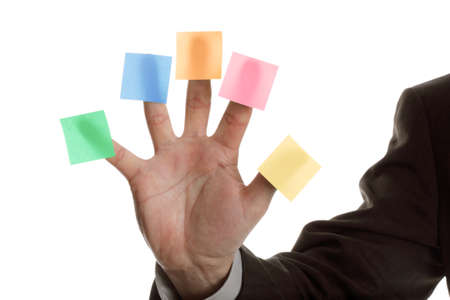 multi coloured: Businessman holds up five blank multi coloured stickies, one on each finger ready for text messages Stock Photo
