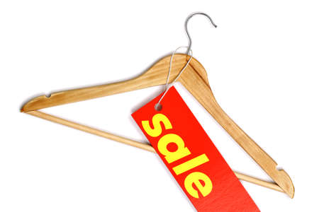 Wooden coat hanger with sale tag photo