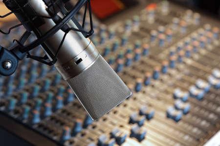 recording studio: Studio microphone in front of mixing console in recording studio