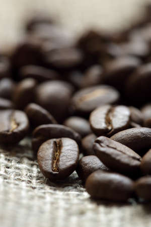 coffee sack: Close up of roasted coffee beans on a burlap sack Stock Photo