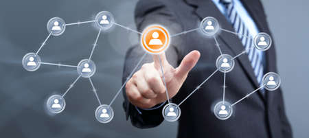 Businessman pressing add friend icon on visual touch screen concept for social media, network, community and  internet marketing Stock Photo - 27251805