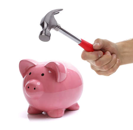 claw hammer: Hand with hammer about to smash piggy bank to get at savings