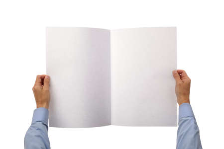 ビジネスマンを保持していると上からコピー スペースで空白の新聞を読む