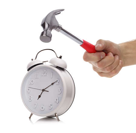 Hand with hammer about to smash alarm clock in the morning photo