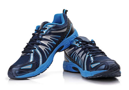 athletic: New unbranded running shoe, sneaker or trainer isolated on white Stock Photo