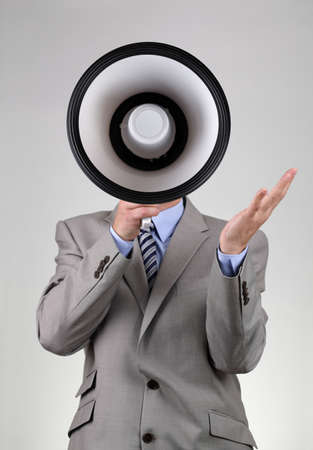 Businessman shouting into a megaphone concept for communication, news, announcement and business motivation photo