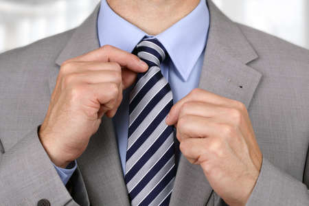 working man: Businessman adjusting his necktie concept for anxiety, worried, meeting or ready for business Stock Photo