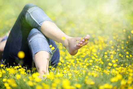 lazy: Relaxing in a meadow full of buttercups in the summer sun Stock Photo