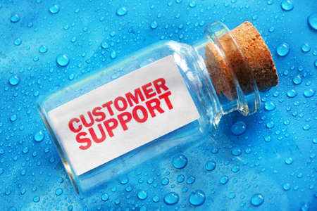 Customer support message in a bottle concept for support, assistance and help photo