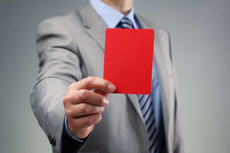 reprimand: Showing the red card concept for bad business practice, exclusion or criminal activity