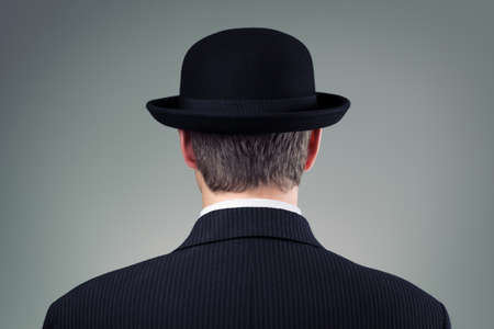 bowler hat: Businessman in bowler hat concept for business, finance, insurance and english culture