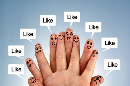 Social network family concept finger people in discussion with like speech bubbles photo