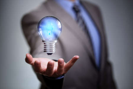 electric light: Businessman with illuminated light bulb concept for idea, innovation and inspiration