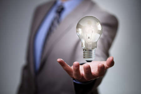 new ideas: Businessman with illuminated light bulb concept for idea, innovation and inspiration