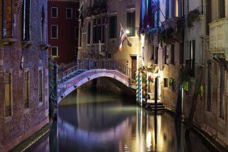 venice bridge: Venice canal late at night with street light illuminating bridge and houses