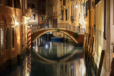 Venice canal late at night with street light illuminating bridge and houses Stock Photo - 29819528