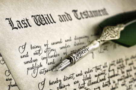 Last Will and Testament document with quill pen and handwriting photo