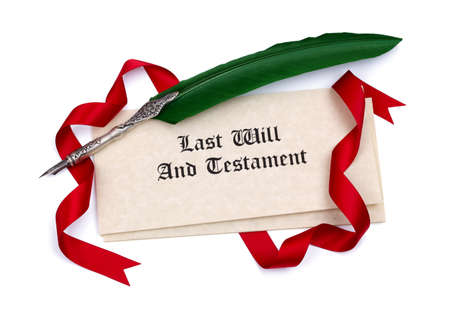 Last Will and Testament papers and quill pen isolated on white
