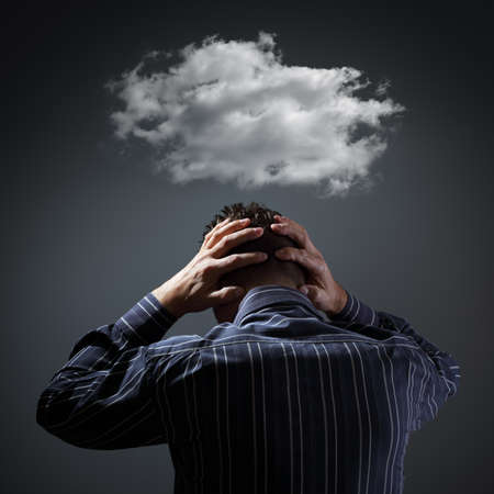 depression: Stress, depression and despair - gloomy storm cloud above mans head