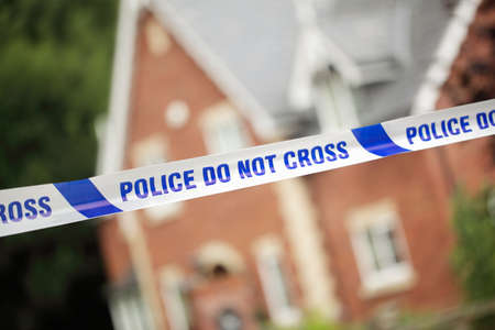 Crime scene investigation police boundary tape concept for law enforcement Stock Photo - 32147708
