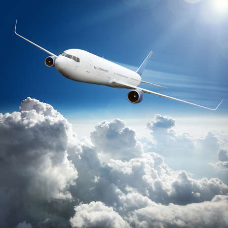 boeing: Passanger airplane flying above dramatic clouds concept for travel and vacations