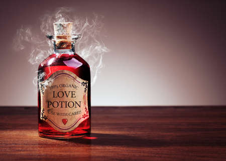 Love potion bottle, concept for dating, romance and valentines day photo
