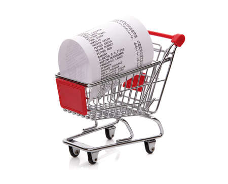 consumerism: Shopping till receipt in cart concept for grocery expenses and consumerism