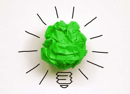 innovation: Inspiration environment concept crumpled green paper light bulb metaphor for good idea and environmental conservation Stock Photo