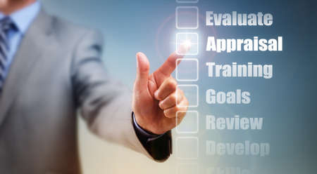 Businessman selecting self improvement options for appraisal, goals and training photo