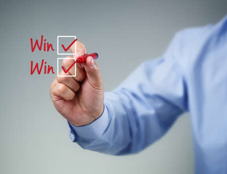business disagreement: Checklist on whiteboard with businessman hand drawing win-win and a check mark in both checkbox