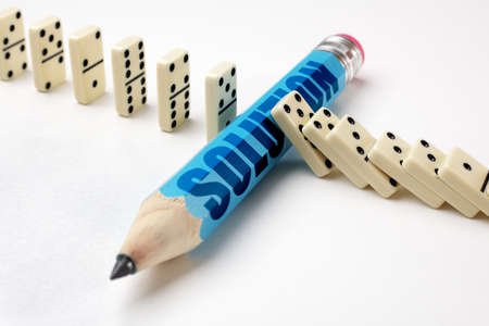 Stopping the domino effect concept for business solution, strategy and successful intervention Stock Photo