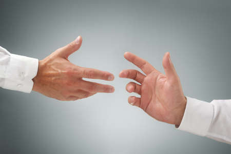 reaching hand: Hand reaching for assistance, support or friendship Stock Photo