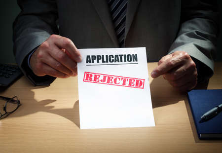 bank: Application has been rejected concept for loan, mortgage, insurance claim form, finance or credit rejection