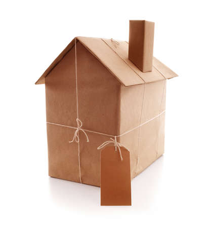 New house wrapped in brown paper concept for real estate, buying a new home, construction or moving house photo