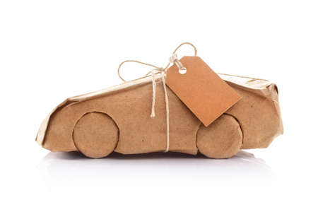 New car wrapped in recycled brown wrapping paper