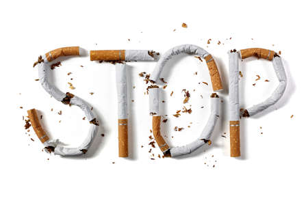 Stop smoking word written with broken cigarette concept for quitting smoking Archivio Fotografico