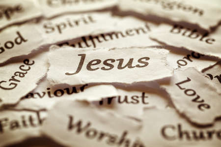 Torn paper words of religion with focus on word Jesus Stok Fotoğraf - 35905320