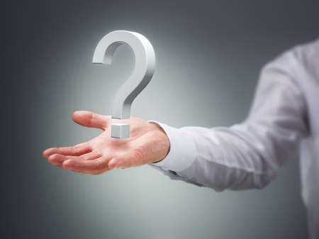 find answers: Businessman holding a virtual question mark concept for confusion, choice, searching or decisions Stock Photo