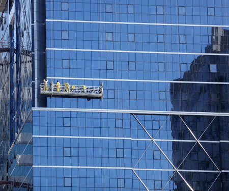 cleaning window: Window cleaner and maintenance on the outside of a skyscraper
