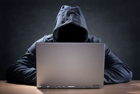 criminals: Computer hacker stealing data from a laptop concept for network security, identity theft and computer crime