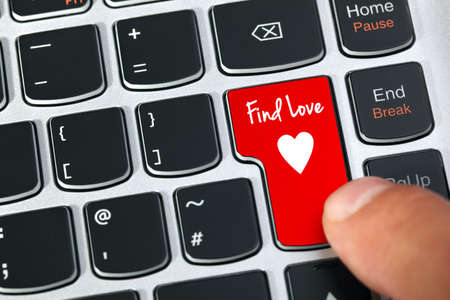 romance sex: Computer keyboard key with find love and heart icon concept for online internet dating Stock Photo
