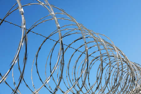 razor wire: Razor and barbed wire fence concept for security and protection