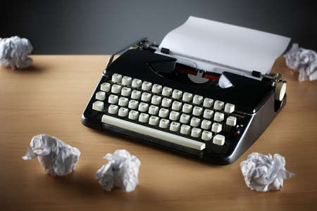 crumpled paper: Frustration stress and writers block with old typewriter on desk and crumpled paper ball