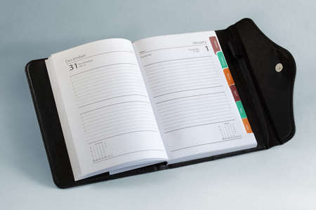 agenda year planner: Diary or personal organizer planner open to blank page