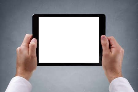 hand touch: Digital tablet with blank white screen held level by businessman ready for content Stock Photo