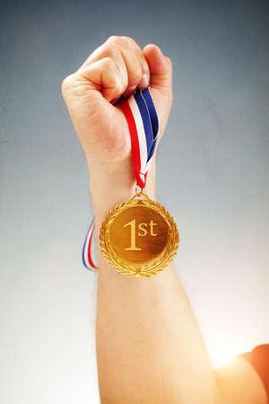winning first: Winning first place hand holding gold medal