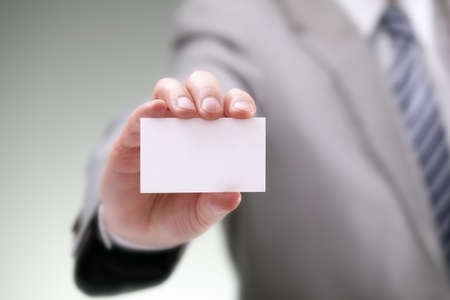 business card in hand: Businessman showing his business card