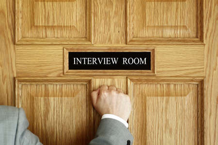 medical checkup: Businessman knocking on interview room door concept for recruitment or medical checkup with a consultant Stock Photo